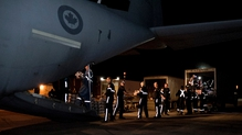 Canadian Armed Forces and local authorities unload emergency food and supplies flown from Edmonton to Horizon in Alberta