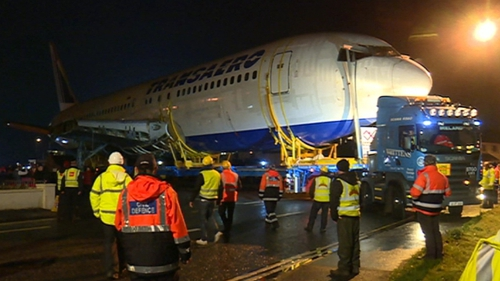 The Boeing 767 was transported by truck and trailer from the beach to the campsite
