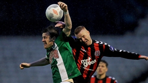 Lorcan Fitzgerald of Bohs battles in the air with with Steven Beattie of Cork
