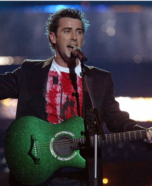 Mickey Harte, who represented Ireland in 2003 - funky boy-next-door look complete with green-lit guitar.