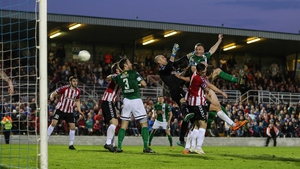 Kenny Browne beats Gerard Doherty to the ball to head Cork to victory