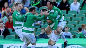 Sheriff YC players mob Mark Higgins after his headed goal