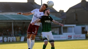 Ryan Brennan of Bray and Galway's Armin Aganovic battle it out in the air