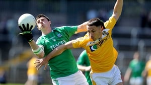Fermanagh's Mickey Jones with Brian Neeson of Antrim tangle for possession