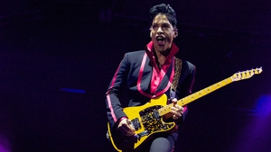 Prince's iconic yellow guitar fetched $137,000