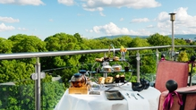 Afternoon Tea while overlooking St Stephens Green from a Deluxe room baloncy