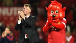 Louis van Gaal and Fred the Red applaud fans at Old Trafford