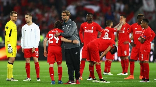 Jurgen Klopp consoles his players at full-time