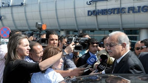 Egyptian Prime Minister Sherif Ismail talks to reporters