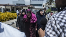 Family members of missing passengers get ready to be transported by bus to Cairo airport