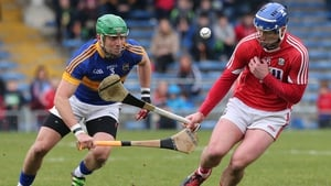 Tipperary's James Barry tackles Patrick Horgan of Cork in the side's league meeting in March