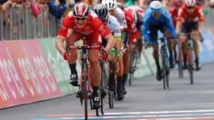 Andre Greipel crosses the finish line in the tourist resort of Bibione