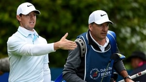 Rory McIlroy played a very steady front nine and picked up a shot, while those around him fell off the pace