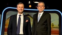 The contest between Norbert Hofer (L) and Alexander van der Bellen in yesterday's election was too close to call