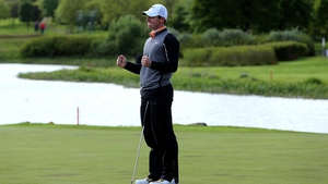 Rory McIlroy celebrates sinking the winning put on the final green at the K Club