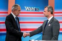 Candidates Alexander van der Bellen (L) and Norbert Hofer (R) shake hands at the state broadcaster in Austria