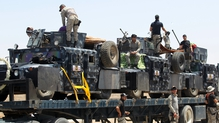 Iraqi forces gathered outside of Falluja ahead of the offensive