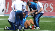 Trainers attend to Ronaldo after he suffered a thigh problem at Real Madrid training