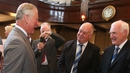 Prince Charles shares a joke with members of Portaferry GAA club at an event yesterday