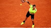 Wawrinka and Nishikori into round three in France
