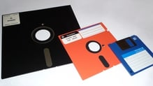 Floppy disks, with the 8-inch on the left (Pic: George Chernilevsky, via Wikimedia Commons)