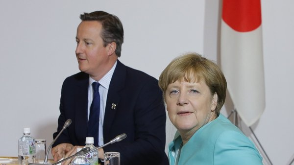 British Prime Minister David Cameron and German Chancellor Angela Merkel meet at the G7 summit in Tokyo