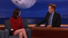 Spot the pale Celtic-skinned one? Caitriona Balfe with Conan O'Brien