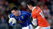 Armagh's Rory Gugan tackles Cavan's Dara McVeety in the Dr McKenna Cup
