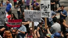 Outside the convention centre in San Diego demonstrators carried signs criticising Donald Trump's rhetoric against illegal immigration