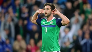 Will Grigg celebrates scoring his side's third goal against Belarus