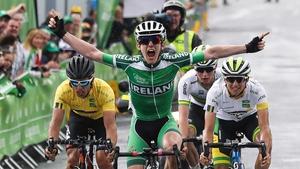 Eddie Dunbar raises his arms as he crosses the line in Baltinglass
