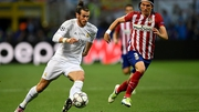 Gareth Bale of Real Madrid runs with the ball past Filipe Luis of Atletico Madrid