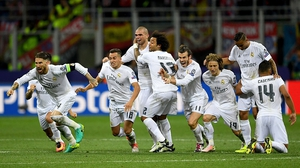 Real Madrid players celebrate after winning the Champions League Final