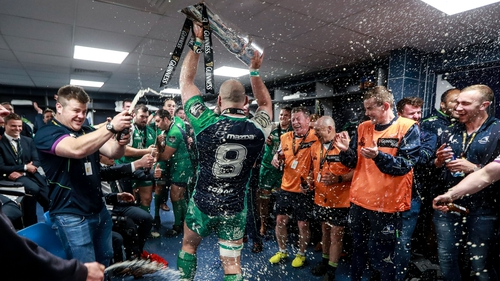 John Muldoon leads the celebrations in the changing room