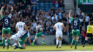Tiernan O'Halloran sprints clear for the opening Connacht try