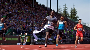Justin Gatlin crosses the finish line in first place at Hayward Field