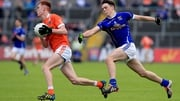 Ross McQuillan of Armagh is pursued by Luke Fortune of Cavan
