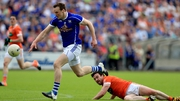 Ross McQuillan with Darragh Kennedy battle for possession