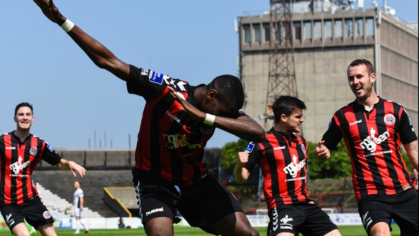 Ismahil Akinade celebrates after scoring the second goal of the game at Dalymount Park
