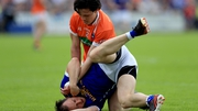 Armagh's James Morgan battles with Seanie Johnston off the ball