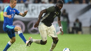 Slovakian midfielder Stanislav Sestak (L) and Germany's defender Antonio Ruediger vie for the ball