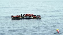 A picture provided by the Italian Navy shows people being rescued at sea