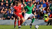 James McClean jinks away from Mikita Korzun of Belarus