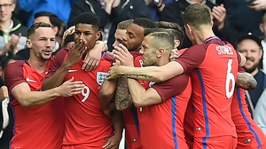 Marcus Rashford is mobbed by team-mates after his goal against Australia