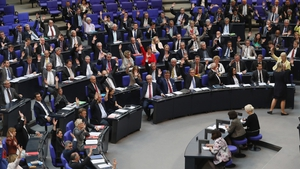 MPs approve with a show of hands a resolution to recognise the 1915 Armenian genocide