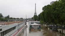 The Eiffel tower and the flooded banks of the river Seine following heavy rainfall in Paris