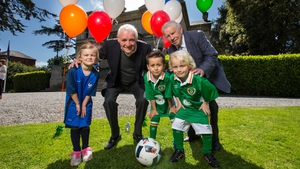 John Giles and Eamon Dunphy alogn with Matilda Byrne, 5, Kyle Doyle, 6, and Kyle Mooney