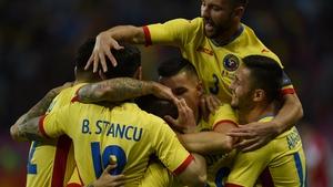 Romania players celebrate scoring