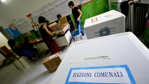 Clerks at a polling station in Naples earlier today