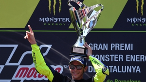 Valentino Rossi held off Spanish rival Marc Marquez to claim victory in a thrilling duel over the final six laps